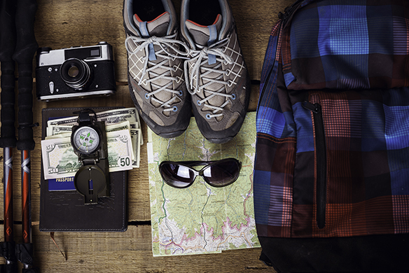travel equipment - hiking boots, map, backpack, trekking poles,
