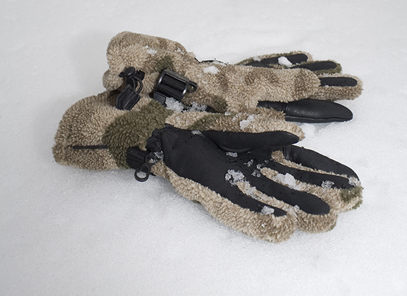 camouflage gloves in the snow