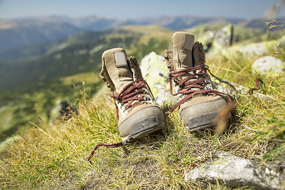 Mountain Hiking Boots in the Summer Grass Outdoor